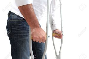 10429649-closeup-of-a-man-walking-with-crutches-Stock-Photo-rehabilitation-injured-accident
